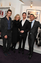 Left to right, SEAN SOUZA, CHARLENE de GANAY, ANTHONY SOUZA and CARLOS SOUZA at a private view of photographs by Anthony Souza held at The Little Black Gallery, 13A Park Walk, London SW10 on 13th December 2011.