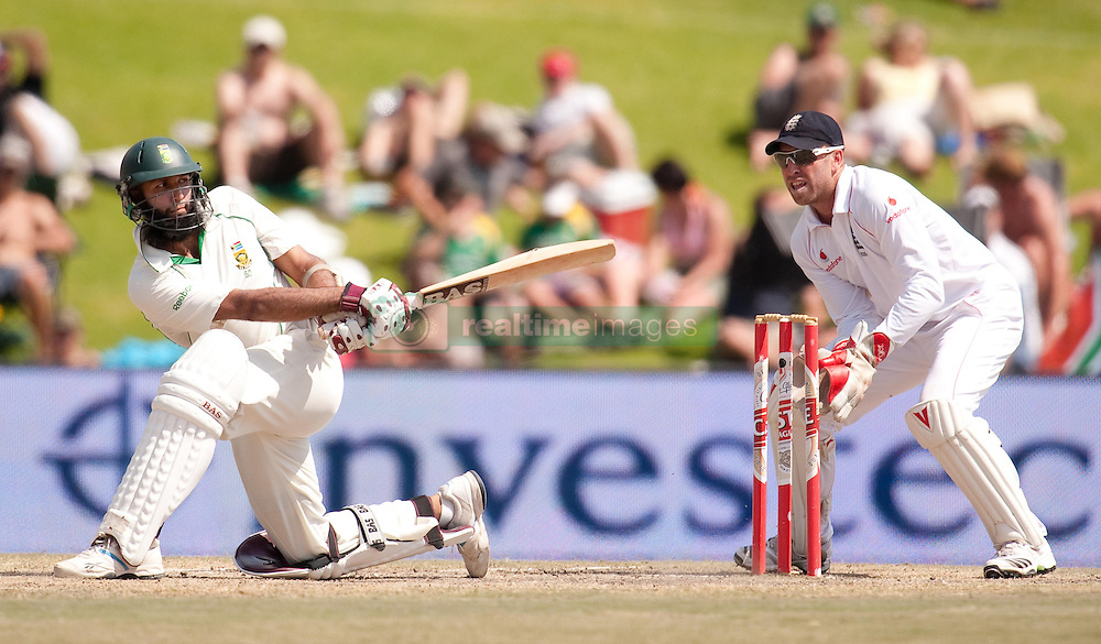 South Africa's Hashim Amla hits past England wicketkeeper Matt Prior during the First Test at the SuperSport Park, Centurion, South Africa.