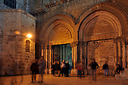 Israel, Jerusalem, Old City, Exterior of the church of the Holy Sepulchre, The main entrance at night .
