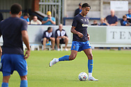 AFC Wimbledon defender Toby Sibbick (20) warming up during the EFL Sky Bet League 1 match between AFC Wimbledon and Scunthorpe United at the Cherry Red Records Stadium, Kingston, England on 15 September 2018.