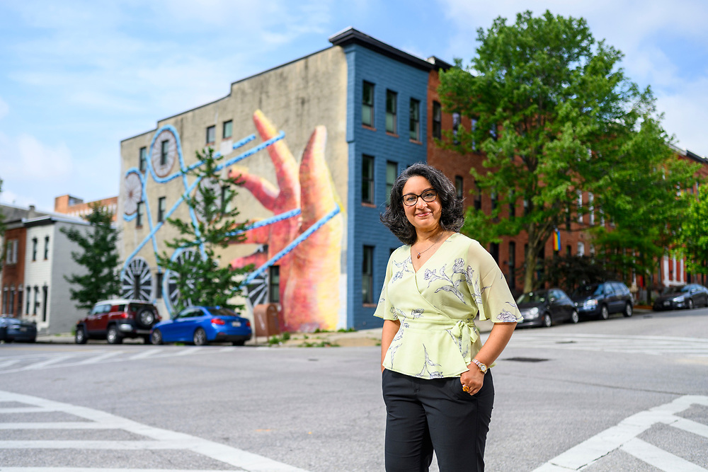 Baltimore, Maryland - June 21, 2021: Seema Iyer is photographed in the Greenmount West neighborhood of Baltimore Monday June 21, 2021. She is Associate Director of the Jacob France Institute of the University of Baltimore and heads the Baltimore Neighborhood Indicators Alliance, which uses data to help tell the story of Baltimore's neighborhoods.<br /> <br /> <br /> CREDIT: Matt Roth for GameChangers