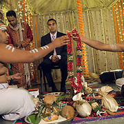 Pujaris at South Indian Traditional Tamil Brahmin Wedding handing over the garland