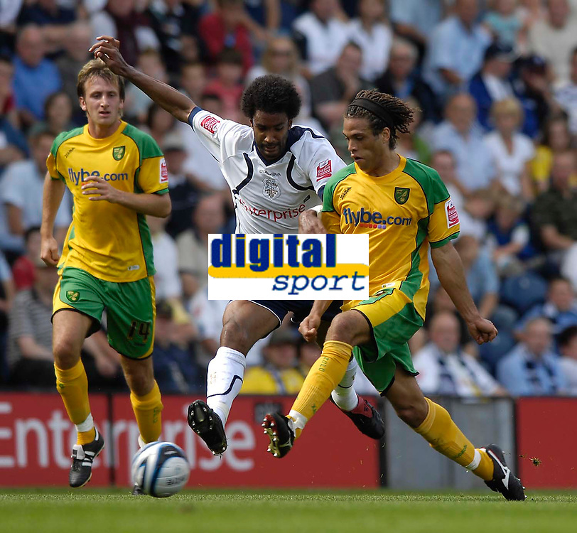 Photo: Jed Wee/Sportsbeat Images. <br /> Preston North End v Norwich City. Coca Cola Championship. 11/08/2007. <br /> <br /> Norwich's Darel Russell (R) is tackled by Preston's Youl Mawene.