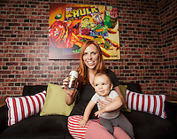 Tiffany Melius has opened the Perky Nerd, a combination coffee shop - comic book store in Burbank, CA. Here her 10-month-old son Jack helps out with a portrait session. Photo by David Sprague