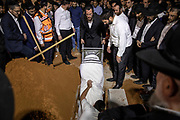 The body of Yedidia Hayut, the 13 year old victim of the Mt. Meron Lag Ba'Omer stampede, is carried during his funeral procession at the Sgula cemetery in Petach Tikva, Israel, May 02, 2021. Some 45 people lost their lives and hundred more were injured as a large crowd was crammed through a narrow corridor at the site of the tomb of the 2nd-century sage Rabi Shimon bar Yochai, also known by his acronym Rashbi.