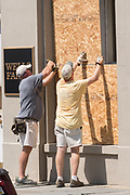 Workers use plywood to cover windows on historic Broad Street in preparation for Hurricane Irma September 8, 2017 in Charleston, South Carolina. Imra is expected to spare the Charleston area but hurricane preparations continue as Irma leaves a path of destruction across the Caribbean.