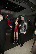 Ali and Michael Hue-Williams, Andy and Patti Wong's Chinese New Year of the Pig party. Madame Tussauds. ( Dress Burlesque, Debauched or Hollywood Black Tie. ) London. 27 January 2007.  -DO NOT ARCHIVE-© Copyright Photograph by Dafydd Jones. 248 Clapham Rd. London SW9 0PZ. Tel 0207 820 0771. www.dafjones.com.