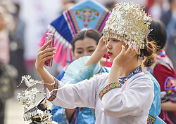 April 18, 2018 - Nanning, Nanning, China - Nanning, CHINA-18th April 2018: People of Zhuang ethnic minority group perform singing and dancing in Nanning, southwest China's Guangxi, celebrating Sanyuesan Festival. Sanyuesan Festival is a folk festival of ethnic minority in China, which takes place on 3rd March in the Lunar Calendar. (Credit Image: © SIPA Asia via ZUMA Wire)