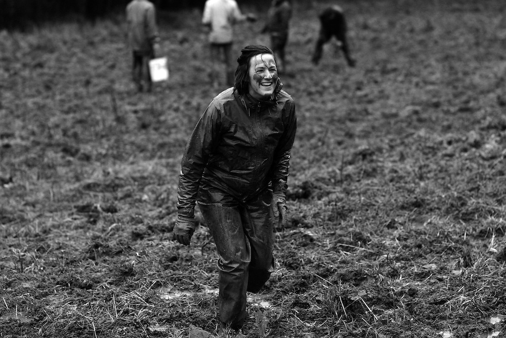 There's always time for a bit of fun at Crop Mob. Crop mob at Eatable Earthscapes. PITTSBORO, NC - MARCH 15: Photo by LOGAN MOCK-BUNTING