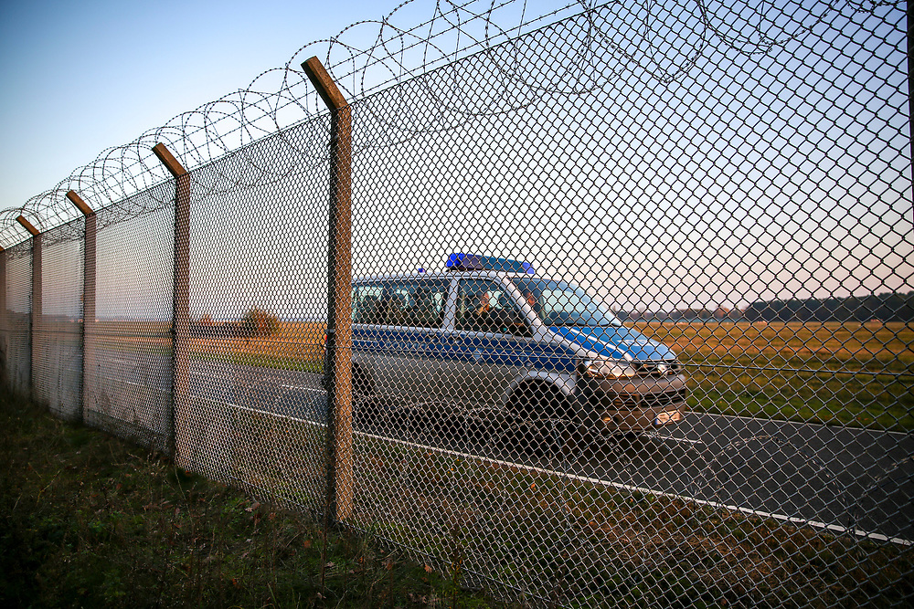A police car patrolls the fence at Tegel Airport (TXL) after a final departure made from the historic airport, Berlin, Germany, November 8, 2020. After more than 60 years Berlin's tiny northern airport is set to shut down all operations, with a final departure flight by AirFrance to Paris. (Photos by Omer Messinger)