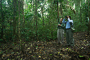 Toruist and guide birdwatching in Jungle, Primary Rainforest, Manu Wildlife Centre, Peru, Amazonian, green, young woman, man.
