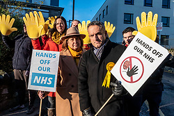 Pictured: Christine Jardine and Alex Cole-Hamilton were joined by activists to protest against tyhe prospect of the NHS Being privatised<br />