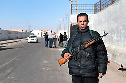 © under license to London News Pictures. 23/02/2011. A border guard and member of the Libyan opposition stands guard at Libya's border with Egypt near the Egyptian town of Salloum. Photo credit should read Michael Graae/London News Pictures