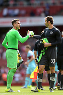 Goalkeeper Petr Cech of Arsenal congratulates Goalkeeper Adrian of West Ham United after the final whistle. Barclays Premier League, Arsenal v West Ham Utd at the Emirates Stadium in London on Sunday 9th August 2015.<br /> pic by John Patrick Fletcher, Andrew Orchard sports photography.