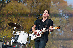 © Licensed to London News Pictures. 12/07/2014. London, UK.   Half Moon Run performing live at Hyde Park as part of the British Summer Time series of outdoor concerts.   In this picture - Devon PortieljeHalf Moon Run are a Canadian indie rock band  consisting of members Devon Portielje (vocals/guitar), Dylan Phillips (vocals/drums), Conner Molander (guitar/keyboard/vocals), and Isaac Symonds (vocals/percussion/mandolin/keyboard/guitar).  Photo credit : Richard Isaac/LNP
