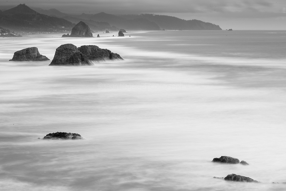 View from Ecola Point looking south across ocean and beach toward Cannon Beach. Ecola State Park, Oregon, USA.