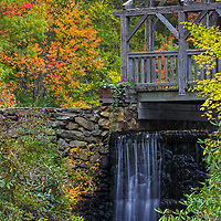 Moore State Park in Paxton is a peaceful retreat in the heart of central Massachusetts. This photo includes the Enchanta Bridge and was taken on a beautiful autumn morning when the overcast sky beautifully balanced the light throughout the autumn scenery, bringing out some of those beautiful fall foliage hues.<br />