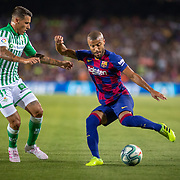 BARCELONA, SPAIN - August 25:  Rafinha #12 of Barcelona defended by Cristian Tello #11 of Real Betis during the Barcelona V  Real Betis, La Liga regular season match at  Estadio Camp Nou on August 25th 2019 in Barcelona, Spain. (Photo by Tim Clayton/Corbis via Getty Images)