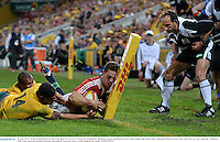 22 June 2013; George North, British & Irish Lions, goes over for a try, which was subsequently disallowed, despite the efforts of Will Genia, behind, and Israel Folau, Australia. British & Irish Lions Tour 2013, 1st Test, Australia v British & Irish Lions, Suncorp Stadium, Brisbane, Queensland, Australia. Picture credit: Stephen McCarthy / SPORTSFILE