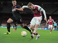 Football - 2020 /2021 UEFA Europa League - Quarter-Final - Arsenal vs Slavia Prague - Emirates Stadium<br /> <br /> Emile Smith - Rowe of Arsenal and Tomas Holes of Slavia Prague<br /> <br /> Credit : COLORSPORT/ANDREW COWIE