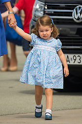 File photo dated 19/07/17 of Princess Charlotte holding the hand of the Duchess of Cambridge as they depart from Chopin airport, in Warsaw, on day three of their five-day tour of Poland and Germany. Princess Charlotte celebrates her fifth birthday today.
