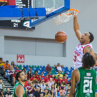 Dior Lowhorn (#33) of the Singapore Slingers dunks the ball against HiTech Bangkok City during the group stage match of the ASEAN Basketball League at the OCBC Arena at the Singapore Sports Hub on August 31, 2014, in Singapore.