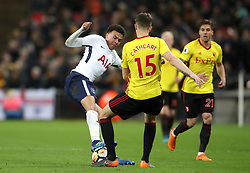 Tottenham Hotspur's Dele Alli (left) and Watford's Craig Cathcart battle for the ball during the Premier League match at Wembley Stadium. London.