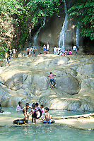 Sai Yok Noi Waterfall in the Tenasserim Hills, is the most popular attraction of the Sai Yok National Park in part because it lies next to the province's trunk road for easy access.  A small market geared toward travellers is also nearby. Sai Yok Yai waterfall, some 40 km west lies off the valley's main road, adjacent to the Sai Yok National Park Headquarters.