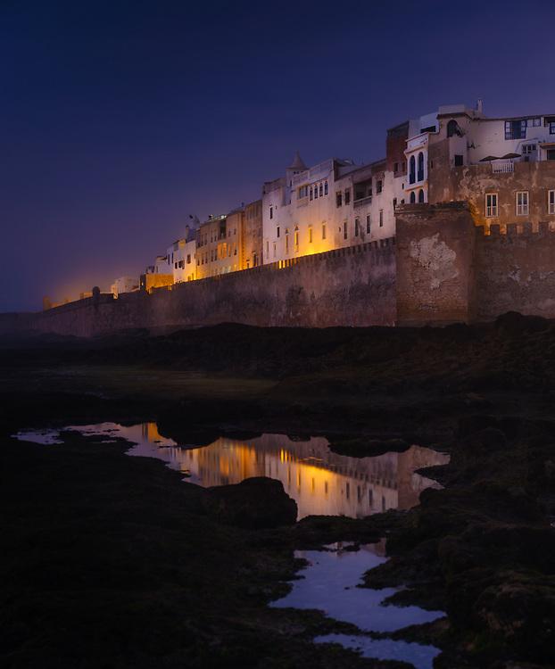 ESSAOUIRA, MOROCCO - CIRCA MAY 2018:  View  of Essaouira, tidal pools and fortified walls at night.