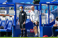 Fourth Official Sam Purkiss wearing face mask next to Queens Park Rangers Manager Mark Warburton during the EFL Sky Bet Championship match between Queens Park Rangers and Barnsley at the Kiyan Prince Foundation Stadium, London, England on 20 June 2020.