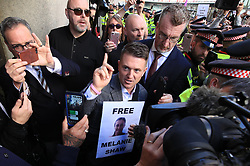 © Licensed to London News Pictures . 27/09/2018. London, UK. Supporters of former EDL leader TOMMY ROBINSON  (real name Stephen Yaxley-Lennon ) outside the Old Bailey , as Robinson faces a delayed retrial for Contempt of Court following his actions outside Leeds Crown Court in May 2018 . Robinson was already serving a suspended sentence for the same offence when convicted in May and served time in jail as a consequence , but the newer conviction was quashed by the Court of Appeal and a retrial ordered . Photo credit: Joel Goodman/LNP