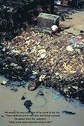 A boy uses the river bank in Cochin as his toilet.<br />There are no dustbins in India and all the litter and rubish ends up in the rivers and waterways causing immense environmental damage and serious health risks.(Environment, water, travel, asia, pollution)<br />Photo © Nic Bothma/iAfrika Photos