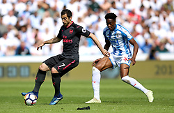 Arsenal's Henrikh Mkhitaryan (left) and Huddersfield Town's Terence Kongolo battle for the ball