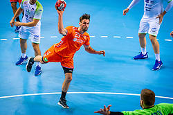 The Dutch handball player Jorn Smits in action against Klemen Ferlin from Slovenia during the European Championship qualifying match on January 6, 2020 in Topsportcentrum Almere