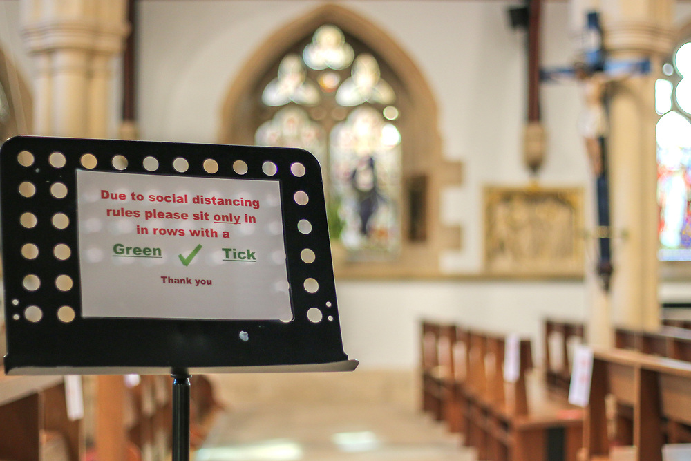 28th February, Cheltenham, England. A sign at the entrance to St Gregory's Catholic Church in Cheltenham advise the congregation to practice social distancing.