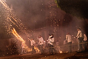 Celebrants representing the Archangel Michael fire sky rockets at the symbolic forces of the Devil from inside the Parroquia San Miguel Archangel church during the Alborada festival in front September 29, 2018 in San Miguel de Allende, Mexico. The unusual festival celebrates the cities patron saint with a two hour-long firework battle at 4am representing the struggle between Saint Michael and Lucifer.
