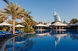 Swimming pool and restaurant pavilions in Al Qasr hotel at Jumeirah Madinat hotels complex in Dubai in United Arab Emirates