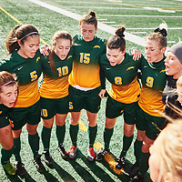 Team huddle prior to the Women's Soccer home game on Sun Oct 14 at U of R Field. Credit: Arthur Ward/Arthur Images