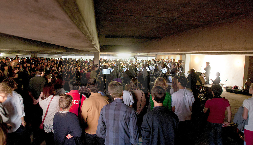 © licensed to London News Pictures. PECKHAM, LONDON, UK.  23/07/11. An audience of 1300 pack into a car park to watch Cambridge University's New Music Ensemble play. Peckham's multi-storey car park plays host to classical club night label Nonclassical's 'The Rite of Spring Project', a unique reworking of composer Igor Stravinsky's landmark composition. Featuring 102 musicians from.Cambridge University New Music Ensemble. Mandatory Credit Michael Derringer/LNP