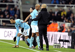 Manchester City's Vincent Kompany (centre) comes off the pitch after picking up an injury during the Premier League match at St James' Park, Newcastle.