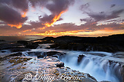 wave surge drains from a lava rock shoreline at sunset, Keahole, North Kona, Hawaii Island ( the Big Island ), Hawaii, U.S.A. ( Central Pacific Ocean )