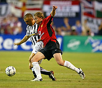 Photo Aidan Ellis.<br />Manchester United v juventus (Champions World Match at New York Giants Stadium East Rutherford).31/07/03.<br />United's Ole Gunnar Solskjær and Juve's Enzo Maresca