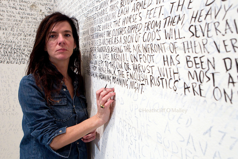 """Mcc0027265 . Daily Telegraph..Artist Fiona Banner at work on a massive wall drawing entitled """"1066, ink on wall 2010"""" for her new solo exhibition at the Frith Street Gallery in London's West End...London 12 November 2010."""