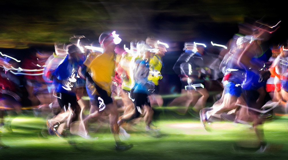Runners are a colorful blur at the start of the Patapsco 50k.