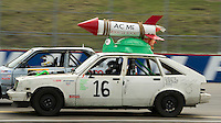 The Acme Rooster Rocket blasts around the race track on Sunday afternoon for the 24 Hours of Lemons race at New Hampshire Motor Speedway.   (Karen Bobotas/for the Concord Monitor)