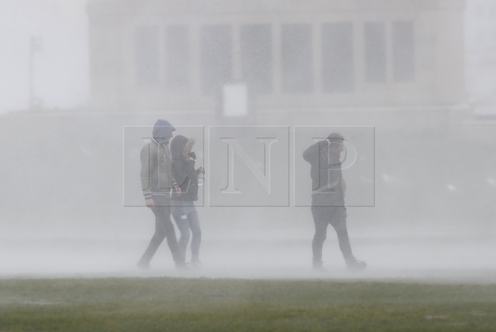 © Licensed to London News Pictures. 09/02/2020. Portsmouth, UK. People are soaked by high waves at Southsea, Portsmouth as Storm Ciara batters the UK. Airlines have cancelled dozens of domestic and international flights as the storm brings strong winds and rain. Photo credit: Peter Macdiarmid/LNP
