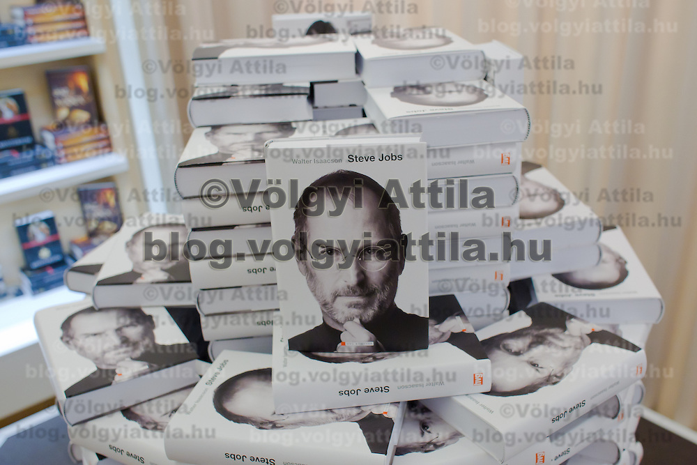 Stack of books is seen during the premiere of the Steve Jobs biography written by Walter Isaacson published in Hungarian translation in Budapest, Hungary on November 28, 2011. ATTILA VOLGYI