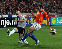 Photo: Paul Thomas.<br /> Holland v England. International Friendly. 15/11/2006.<br /> <br /> Joris Mathijsen (R) of Holland can't stop Andrew Johnson from crossing.