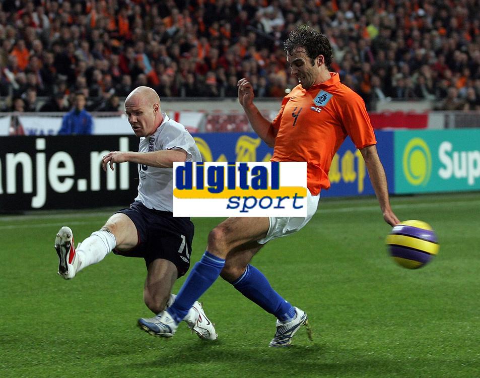 Photo: Paul Thomas.<br /> Holland v England. International Friendly. 15/11/2006.<br /> <br /> Joris Mathijsen (R) of Holland can't stop Andrew Johnson from crossing.