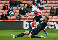 Sheffield United's David McGoldrick shoots under pressure from Burnley's Charlie Taylor<br /> <br /> Photographer Alex Dodd/CameraSport<br /> <br /> The Premier League - Sheffield United v Burnley - Sunday 23rd May 2021 - Bramall Lane - Sheffield<br /> <br /> World Copyright © 2021 CameraSport. All rights reserved. 43 Linden Ave. Countesthorpe. Leicester. England. LE8 5PG - Tel: +44 (0) 116 277 4147 - admin@camerasport.com - www.camerasport.com